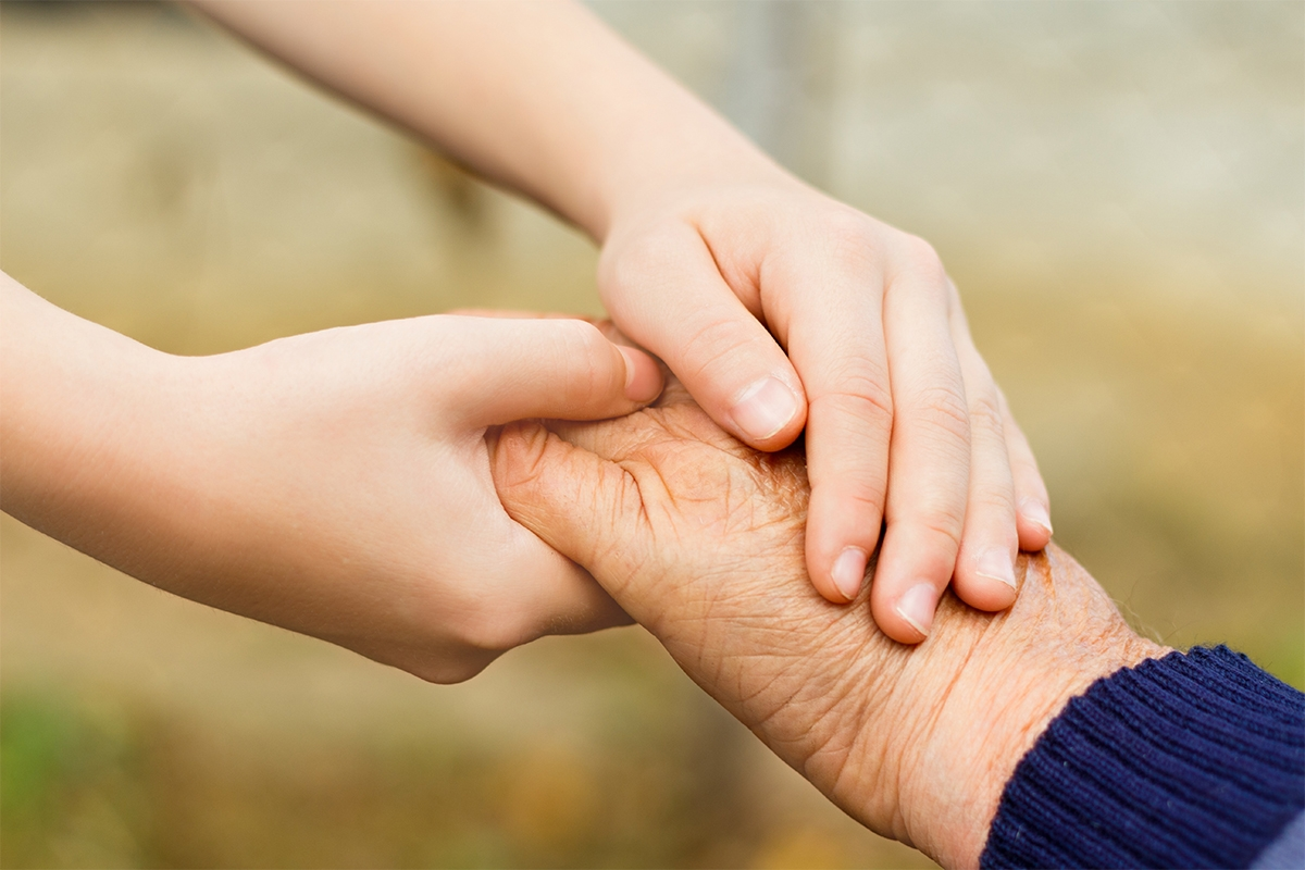 young carers holding hands with elderly patients